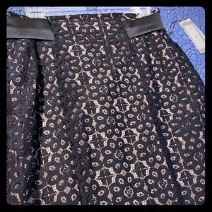 Laced pencil skirt.